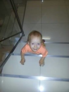 Nicky climbing up stairs