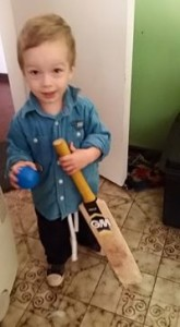 toddler with bat and ball