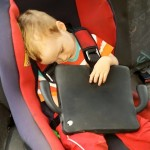 toddler sleeping in the car with IPad