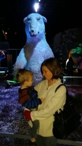 toddler and mom in front of bear at ice age exhibition