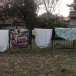 sheets and duvet covers on the pool fence