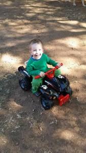 three year old on toy quad bike