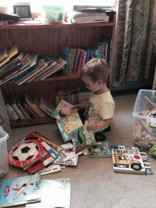 three year old with books