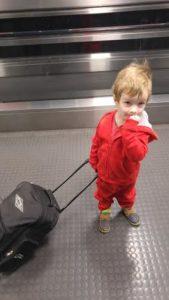 kid pulling suitcase