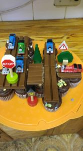 train cake with cupcakes
